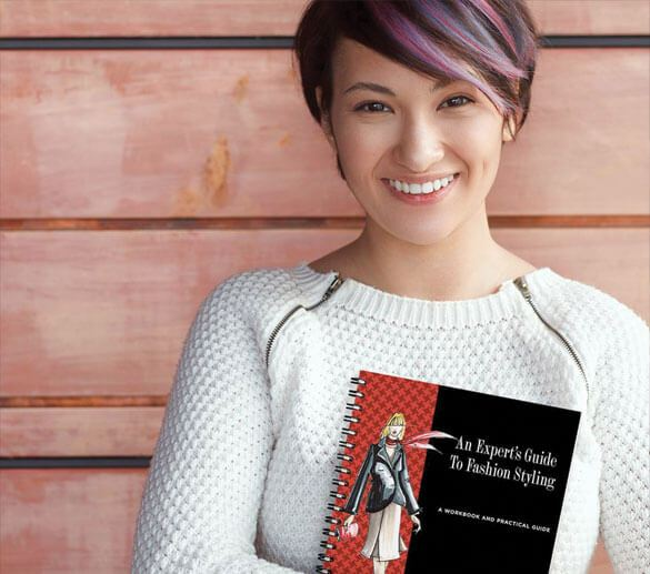 Woman holding An Experts Guide To Fashion Styling book