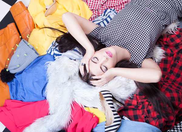 Woman on pile of clothes